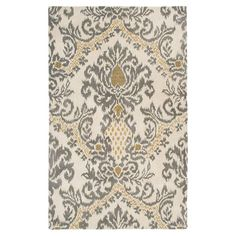 Wool rug with an ikat-inspired motif. Hand-tufted in India.   Product: RugConstruction Material: Wool