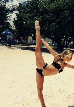 Cheerleader in black bikini on beach posing grace form sand #cheer #KyFun