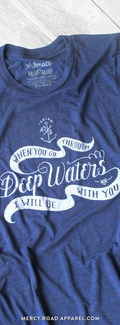 "Nautical Christian T-Shirt with Isaiah 43:2 ""When you go through deep waters, I will be with you"". this scripture shirt is handcrafted and screenprinted on a gloriously comfy navy blue triblend tee. Quality Christian clothing for women and men. FREE SHIPPING USA.  Shop >> MercyRoadApparel.com"