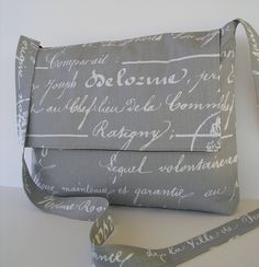 Messenger Bag / Crossbody Bag / Laptop / iPad / Diaper bag in Grey Script. $35.00, via Etsy.