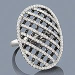 Featuring a fabulous black and white diamond criss cross design and a highly polished gold finish, this ladies diamond cocktail ring is available in 14K white, yellow and rose gold. Available at www.itshot.com.