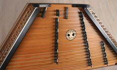 2012 - #1597 - A James Jones 3/16/18/9 Custom Hammered Dulcimer with a Walnut frame, Redwood SB, Peruvian Walnut pin panels, with Walnut bridges made black and Wenge trim. Walnut, made black, dampers.