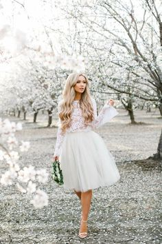 Our whimsical Audrey lace crop top is made with lustrous, white, stretch lace and has beautiful, full-length bell sleeves with scalloped hems -- a perfect pairing with any of our tulle skirts! - Avail