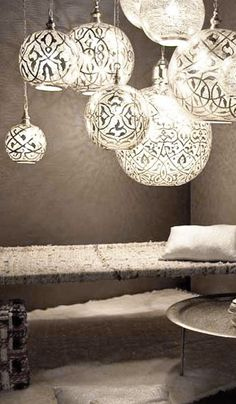Moroccan influence - Love the airiness of these and the beautiful light patterns they give off. - Model Home Interior Design Moroccan Design, Moroccan Decor, Moroccan Lanterns, Moroccan Style, Moroccan Lighting, Home Lighting, Lighting Design, Pendant Lighting, Bedroom Lighting