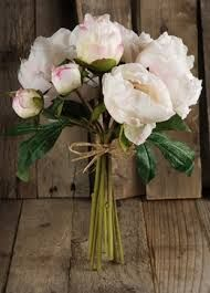 Another bridesmaid bouquet idea keeping the long stems for a casual effect and tying with a single satin ribbon.