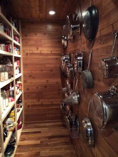 Love the idea of hanging all the pots and pans on the wall.