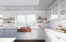 This charming copper kitchen showcases a transitional style that's perfect for hosting guests and dinner parties. The elegant white space has been accented with eye-catching rose gold and copper finishes