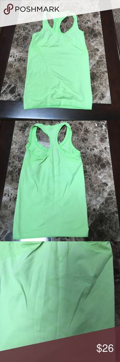 Lime green work out tank. Lime neon green VSX sport work out racer back tank. Good condition. 61% nylon 31% polyester and 8% elastane. Worn a hand full of times Victoria's Secret Tops Tank Tops