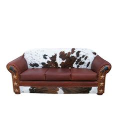 Western sofa with cowhide, leather, conchos and hand-painted artwork, Fully Customizable | Western furniture and decor from RusticArtistry.com