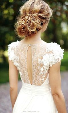 Bride's #curly #chignon #hair ideas ToniK...I love the dress even more than the hair!