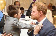 The prince delighted the little boy by making faces as they were introduced at tonight's awards