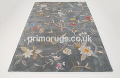 This contour rug in slate is creatively handtufted using 100% Polyester to great quality.