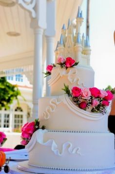 One of the blogs most popular Disney wedding cakes, complete with edible white chocolate topper created to look like Cinderellas castle (from Walt Disneys Worlds Magic Kingdom). This cake is from Brittany and Ryans EPCOT wedding. CLICK TO LEARN HOW TO MAKE THIS CAKE !!