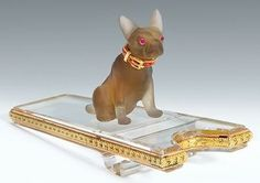 Gold, hardstone, rock crystal and jewelled Pen Rest bearing marks for Faberge and workmaster Michael Perchin, St Petersburg, the pen rest surmounted by a carved miniature pug dog, with jewelled eyes and enamel collar, seated on a rock crystal two colour gold mounted boot jack pen rest.