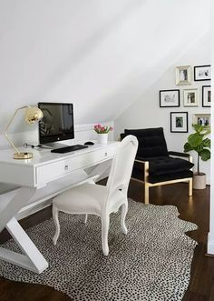 White office with hardwood floors and animal print rug