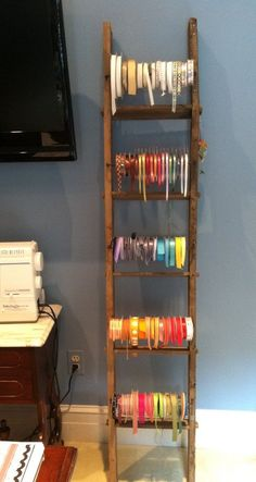 Display your ribbon collection on an old ladder. | Community Post: 45 Organization Hacks To Transform Your Craft Room