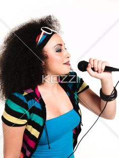 fashionable young woman singing song over microphone. - Fashionable young woman singing song over microphone against white background, Model: Taylor Chmiel
