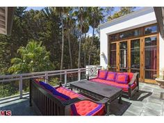 28830 Bison Ct, Malibu, CA 90265 — Quintessential and tranquil living awaits you in this ultimate Balinese oasis. A tropical sanctuary located on idyllic Point Dume, this private/gated custom designed home fuses the best of indoor and outdoor style living. Enter through the intricately carved doors into this extraordinary home with its beautiful executed details throughout. The open floor plan takes you from the black and white mosaic floor entry way into a formal living room that doubles as…
