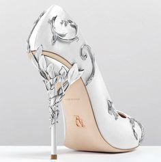 Love these white satin pumps with silver leaves.
