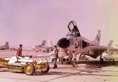 A USN Douglas F4D Skyray getting loaded with some AIM-9B Sidewinders.