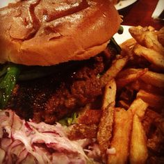 The Duck - Urban Taphouse, Cardiff A hoisin duck patty topped with grilled peppers and spring onions, with coriander (cilantro) in a toasted brioche bun with some shredded lettuce. Served with homemade 'slaw and skin on skinny fries.