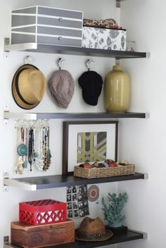 From Inspiring Pretty:  set up an accessory station (walk-in closet would be ideal)