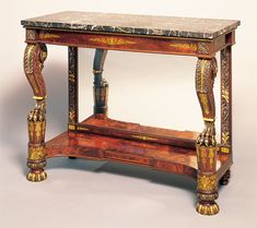 "From: ""Classical Furniture in Federal Philadelphia"" - Carved, Gilt Stenciled and Bronze-Powder Paint Decorated Mahogany Pier Table, Attributed to Anthony G. Quervelle, Philadelphia, circa 1825-1830. H. 38-1/2 W. 47-1/2, D. 22 in. Private collection. Photography courtesy of Carswell Rush Berlin, Inc., New York."