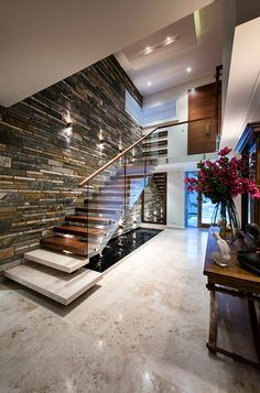 stone finish on walls combined with marble floors rough and smooth, but better to use same colours