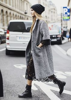 knee length coat with a lace dress and combat boots