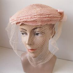 I have such a fondness for soft pink vintage hats with net veils, like this elegant one from the 1950's