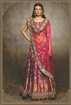 Asha & Gautam Gupta--A purple Khinkhab lehenga draped with a french rose pink net dupatta