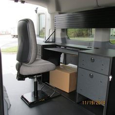 A full size Mobile Office installed in a mid-rise 2015 Ford Transit.