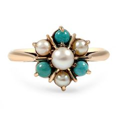 The Caprice Ring.  This feminine and floral inspired ring features a lustrous white pearl centered among a halo of turquoise cabochons and cultured pearls for a delicate appeal.