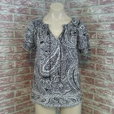 """Black White Paisley Keyhole Tie Blouse Excellent pre-owned condition. Smocked elastic stretch neckline and sleeve hem. V-Neck cut with tasseled ties for a keyhole style if you choose. Bust measures 40"""" and length is 20"""".   PM280 Outback Red Tops Blouses"""