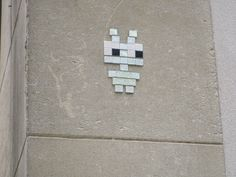 Cool Stuff in Paris | A gallery of space invader pixel art tile mosaics in Paris, on Rue des Barres, around the corner from Eglise Saint-Gervais