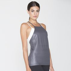 """Sleek layering tank in chintzed """"wet look"""" performance jersey. Enhanced moisture wicking/quick dry technology with smooth, chafe-free flatlock seams. Reflective :59 logo.  #FIONATANK"""