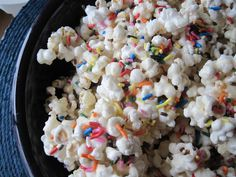 Cake Batter Popcorn  6 cups popped pop corn; 1 1/2 cups almond bark or white chocolate, melted; 1 cup yellow or white cake batter mix; 1/4 cup veg shortening;  sprinkles.  Melt almond bark/chocolate in the microwave - 30 second intervals stirring between until fully melted.   Add shortening and stir til melted. Pour over popcorn. Sprinkle. Cool.