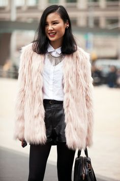 Leather shorts over black opaque tights, crisp white button-down, collar necklace, fuzzy fur coat <3