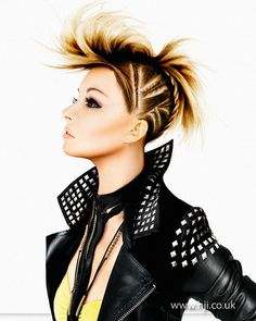 2012 braided quiff womens hair hairstyle    Long blonde hair was corn-rowed up the head in angular lines, leaving the ends loose on top of the head to create an almost mohawk-like effect. Ends were then styled with straighteners and hairspray to enhance the effect.     Hairstyle by: Julian Holland  Salon: Mark Hill Salon  Location: East Yorkshire