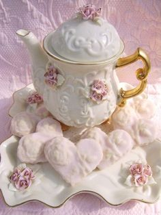beautiful gilded pink rose tea pot, accompanied by a heart-shaped dessert on pretty matching serving dish