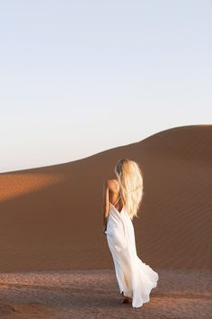 sleath wedding dress, girl standing in white gown in the desert Caitlin Hartley of It Girl Weddings http://itgirlweddings.com/desert-editorial-shoot/