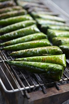 Rice wrapped in pandan leaves on the BBQ