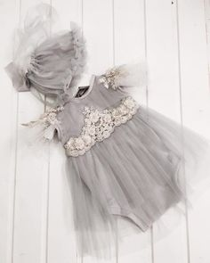 Baby romper dress made from grey cotton and tull , with lace embroidery .Bonnet included .