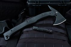 "gunsknivesgear:  LFT-1 Tactical Tomahawk from Hardcore...gunsknivesgear:  LFT-1 Tactical Tomahawk from Hardcore Hardware.  At 12.6"" length and weighing just 2"", this breaching tool puts devastation in a compact package."