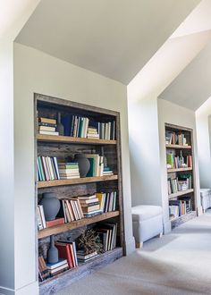 Reclaimed Wood Bookcase. Built in Reclaimed Wood Bookcase. Hallway with Built in Reclaimed Wood Bookcases. #ReclaimedWood #Bookcase #BuiltinBookcases Alyssa Rosenheck Photography. Castle Homes.