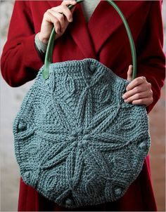 """This beautiful crocheted bag by Linda Permann is decorated with a winter motif but perfect for every season. A pretty snowflake-style bag that is worked flat in two identical circular pieces, each constructed from the center out... [caption id="""""""" align=""""aligncenter"""" width=""""350""""] Advertisement[/caption]"""