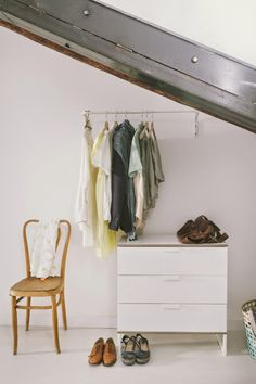 Cloth rack above a drawer