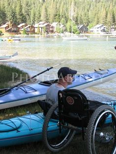 Photo by Andrea Jehn Kennedy wheelchair;man;male;disability;disabled;access;accessible;inclusive;river;adventure;canoe;summer