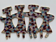 Wall sculpture art.  Happy and light.  Original, painted on the back of the acrylic and faces are carved through the paint.