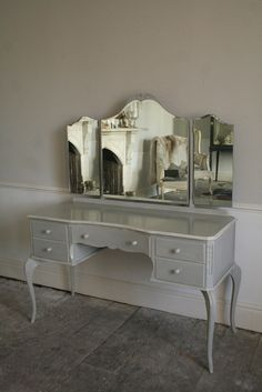 Glamorous Vintage Dressing Table..I really need to do some estate sale shopping soon!  I'd love to find something like this.